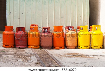 any colored gas cylinders on street - stock photo