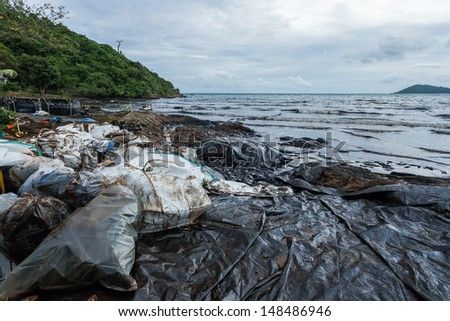 Ao Prao Beach was full of crude oil and dirty bag on oil spill accident on Ao Prao Beach at Samet island on July 31,2013 in Rayong,Thailand - stock photo