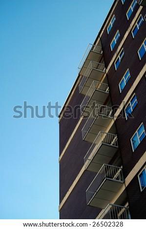 apartment building against clear blue sky; Calgary, Alberta - stock photo