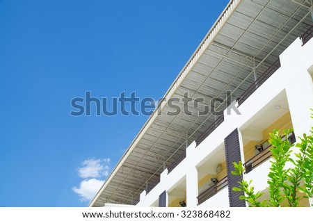 apartment building for rent with sky background - stock photo