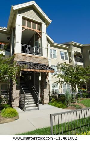 Apartment building in suburban area - stock photo