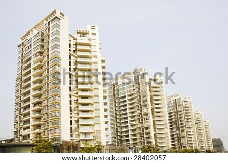 Apartment building isolated on sky - stock photo