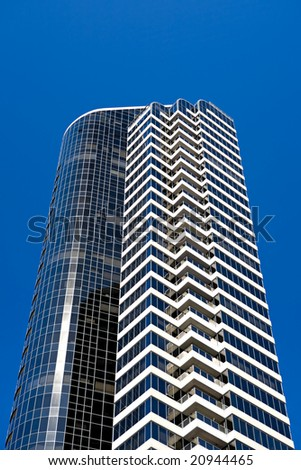 apartment building modern style against clear blue sky - stock photo