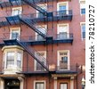 Apartment building with exterior fire escape - stock photo
