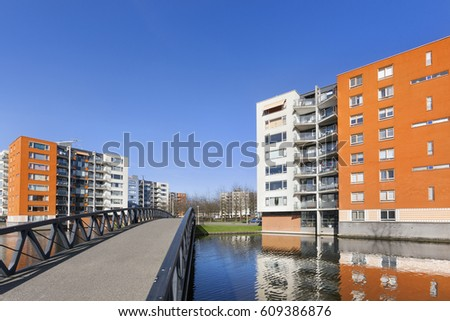 Apartment Buildings And Water In Residential District Prinsenland In  Rotterdam In The Netherlands