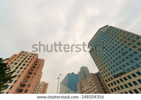Apartment buildings in daytime under sky in Hong Kong, China, Asia. - stock photo