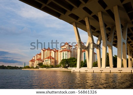 Apartment Buildings in Singapore Seen from the Water. - stock photo
