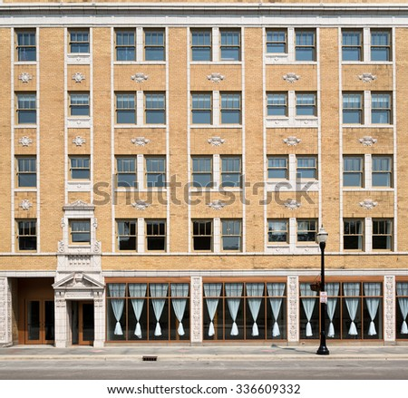 Apartment complex and windows. Symmetry - stock photo