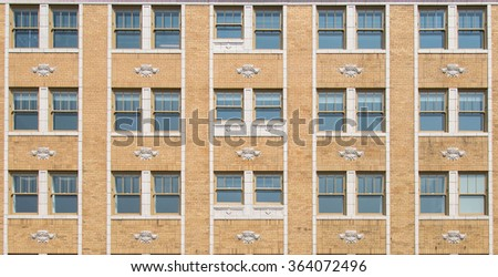 Apartment complex and windows. Symmetry