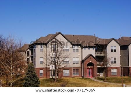 Apartment Complex Brick Building during Winter - stock photo