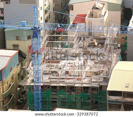 Apartment construction site in a densely populated neighborhood