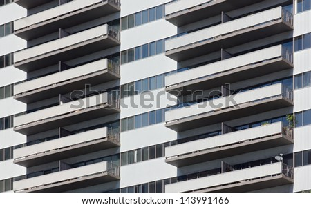 Apartment high riser with balconies on each floor - stock photo
