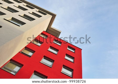 Apartment house, town building on blue sky - stock photo