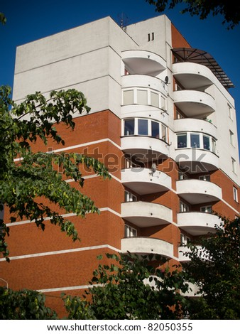 Apartment houses in sunny day and with blue sky. Lodz, Poland - stock photo