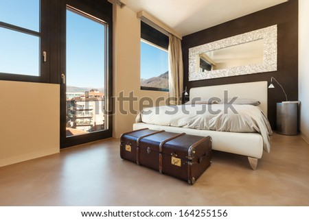 apartment in new building, comfortable double bed - stock photo