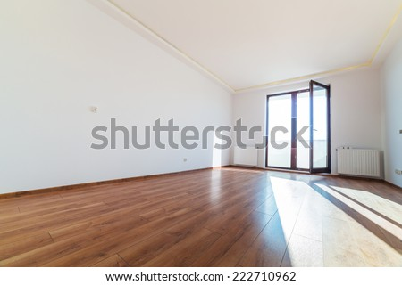 Apartment interior with wooden floor after renovation - stock photo