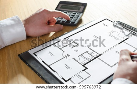 Architect Working On Blueprint Architects Workplace Stock