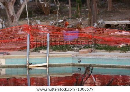 Apartment swimming pool destroyed by Hurricane Katrina. - stock photo