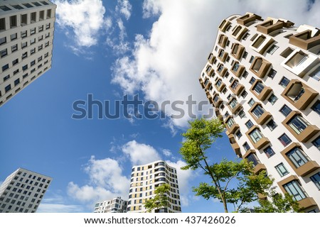 Apartment towers in the city - Facade of new modern residential buildings  - stock photo