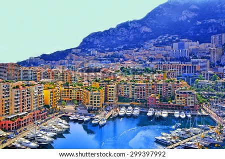Apartments and luxury yachts in the harbor of Monte Carlo, Monaco, Europe. - stock photo
