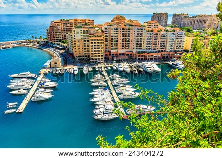 Apartments,harbor,and luxury yachts in the bay,Monte Carlo,Monaco,Europe  - stock photo