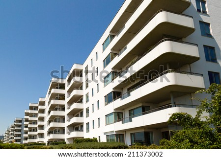 Apartments on a sunny summer day in Hellerup, a suburb of Copenhagen, Denmark. - stock photo