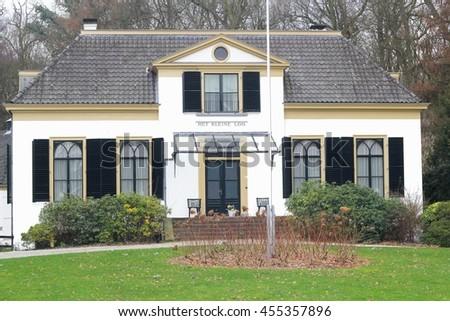 APELDOORN, NETHERLANDS - February 22. Heritage building and cultural monument Het Kleine Loo belongs to Palace Het Loo on February 22, 2014 in Apeldoorn.  - stock photo