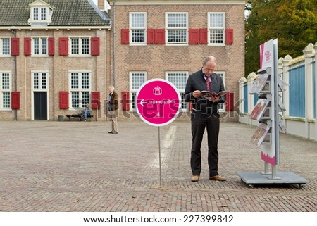 Apeldoorn, Netherlands - October 31, 2014: Visitors at the entrance to Het Loo Palace in Apeldoorn. - stock photo