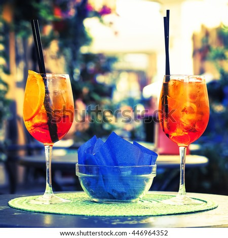 Aperol Spritz Cocktail. Alcoholic beverage on table with ice cubes and oranges. - stock photo