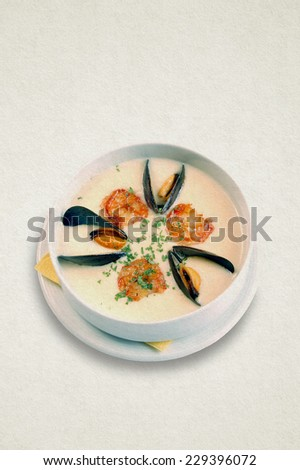 Apettizing creamy soup in white plate. White potato soup with seafood, shrimp and mussels. Paper background (retro style toning). - stock photo