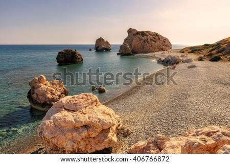 Aphrodite Beach at sunset, the birthplace of Aphrodite on Mediterranean sea, Paphos. Cyprus. - stock photo