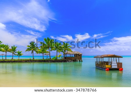 Apia, Samoa. Hut and boat by the beach. - stock photo