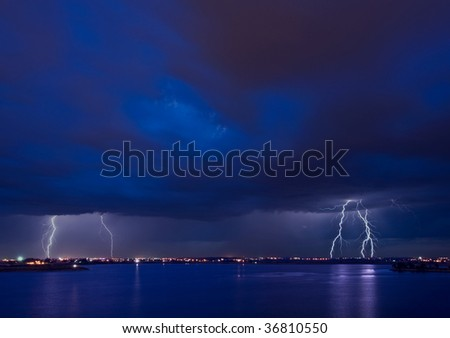 Apocalypto - lightning strikes over a lake and over the city