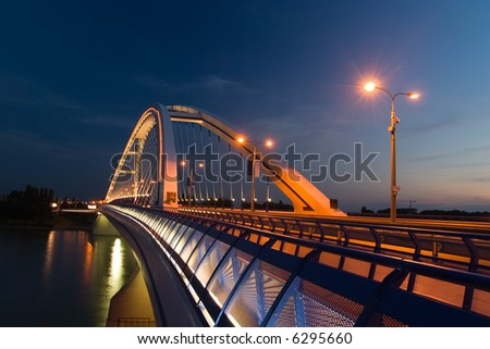 Apollo bridge in Bratislava in Slovakia in the evening - stock photo