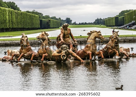 Apollo Fountain (Bassin d'Apollon, constructed in 1668 - 1671, depicts sun god driving his chariot to light sky) in Garden of Versailles. Palace Versailles was a royal chateau. Versailles, France. - stock photo