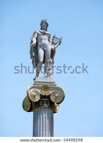 Apollo staue on a column capital - stock photo