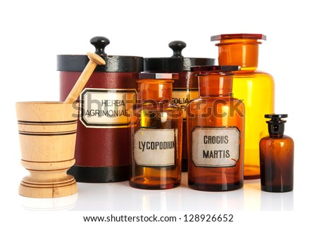 apothecary pots with ingredients for medicins isolated over white background - stock photo