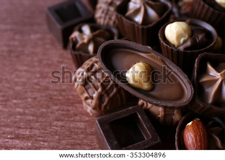Appetizer chocolate candies on wooden background