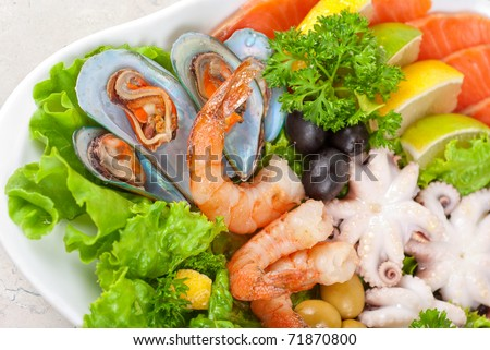 appetizer closeup of different seafood and vegetables - stock photo