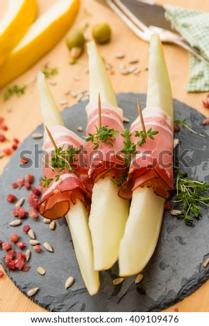 appetizer melon with ham - stock photo