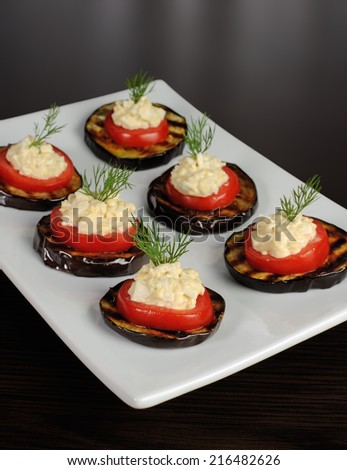 appetizer of grilled eggplant with tomato and spicy stuffing