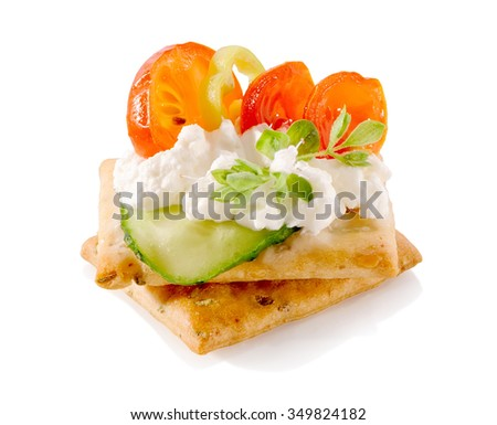 appetizer on crackers with cream cheese and vegetables close-up isolated on white background  - stock photo