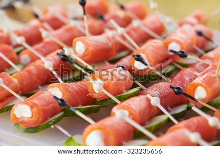 appetizer on skewers with red fish