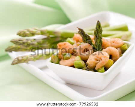Appetizer with baked shrimp and asparagus. Selective focus, shallow depth - stock photo