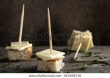 Appetizer with cheese on a wooden table, selective focus - stock photo