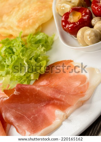 Appetizer with ham, fried dumplings and, close-up