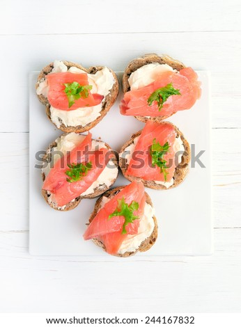 Appetizer with salmon and cottage cheese cream, top view - stock photo