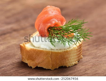 Appetizer with salmon and dill, close up view - stock photo
