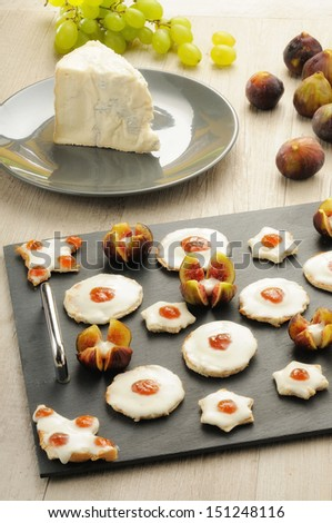 Appetizers canapes with cheese and fig jam