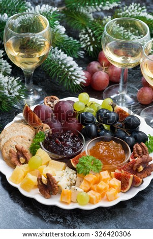 appetizers - cheeses, fruits and jams, vertical, top view - stock photo